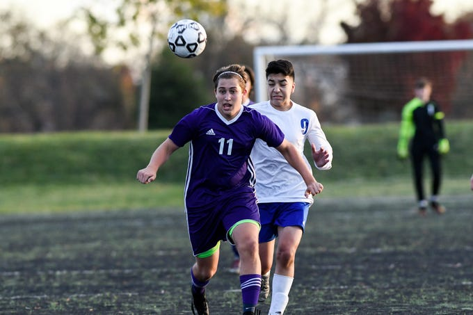 Shasta's Elijia Astin (left) chases after the ball ahead of Anderson's James McNeal during Shasta's 5-1 win over Anderson on Saturday. Astin scored his first goal of the season in the game.