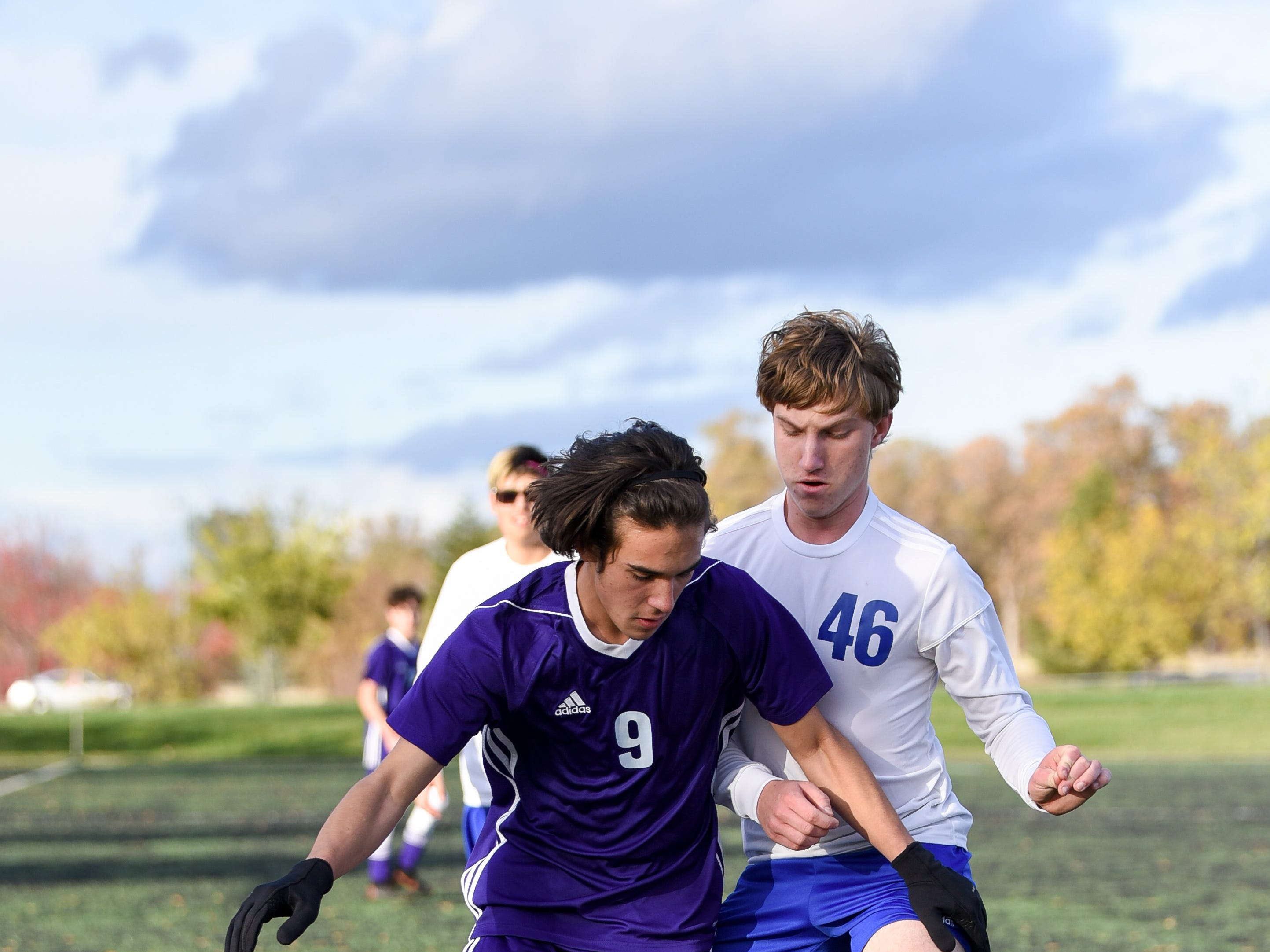 Shasta's Nick Barnett (left) holds the ball away from Anderson's Simon Griggs on Saturday at the California Soccer Park.