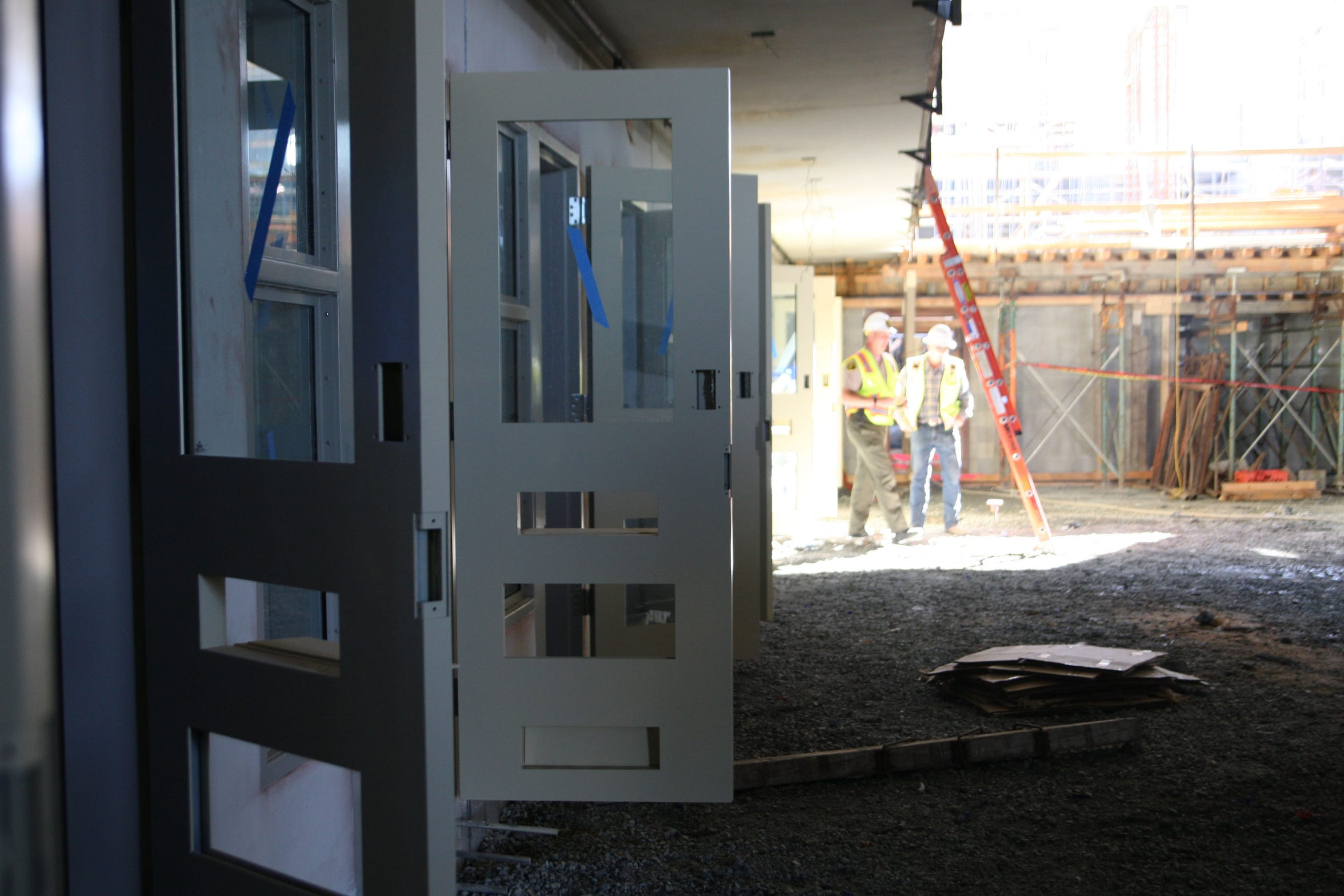 Cell doors hang open on an unfinished floor of the Monterey County Jail.