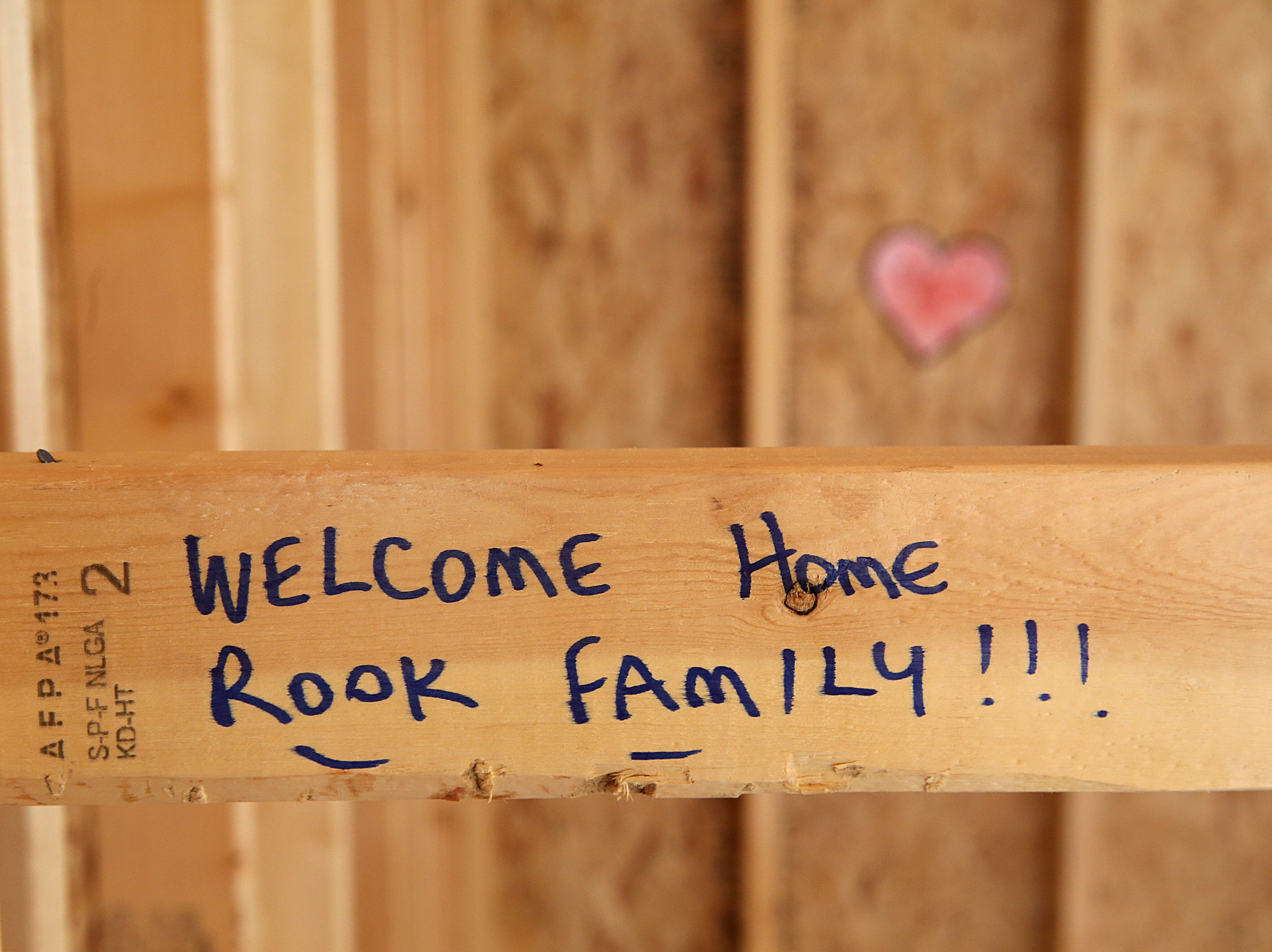 Messages of support for Army Pfc. Ian Rook and his family are written on the inside of the family's unfinished home Tuesday, Dec. 4, 2018. The Rooks received a mortgage-free home as part of Operation Finally Home.