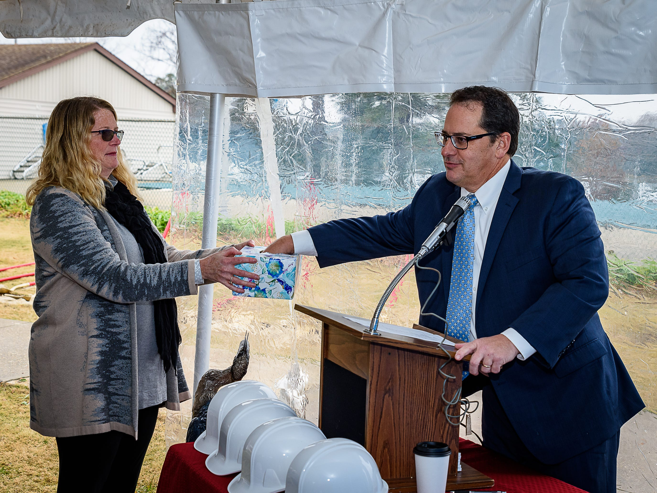 "Eastern Shore Yacht and Country Club President Stephen McClaskey draws the winning ticket  for the ""Basket Of Cheer"" raffle at the groundbreaking."