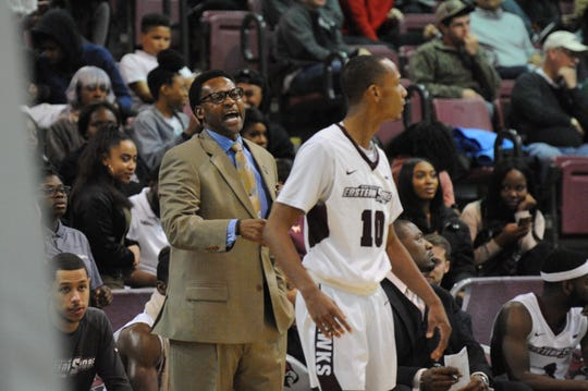 University of Maryland Eastern Shore interim men's basketball coach Cliff Reed shouts to one of his player against Delaware on Friday, Nov. 30, 2018.