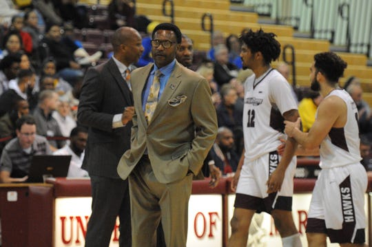 University of Maryland Eastern Shore interim men's basketball coach Cliff Reed calls a timeout against Delaware on Friday, Nov. 30, 2018.