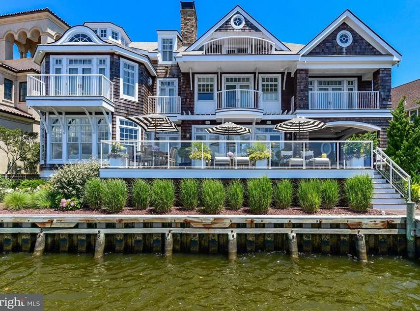 This beautiful Ocean City home located at 317 S. Heron Gull Ct. The home is 6,454 square feet. It has six bedrooms and five full bathrooms. Its available for 3.4 million dollars.