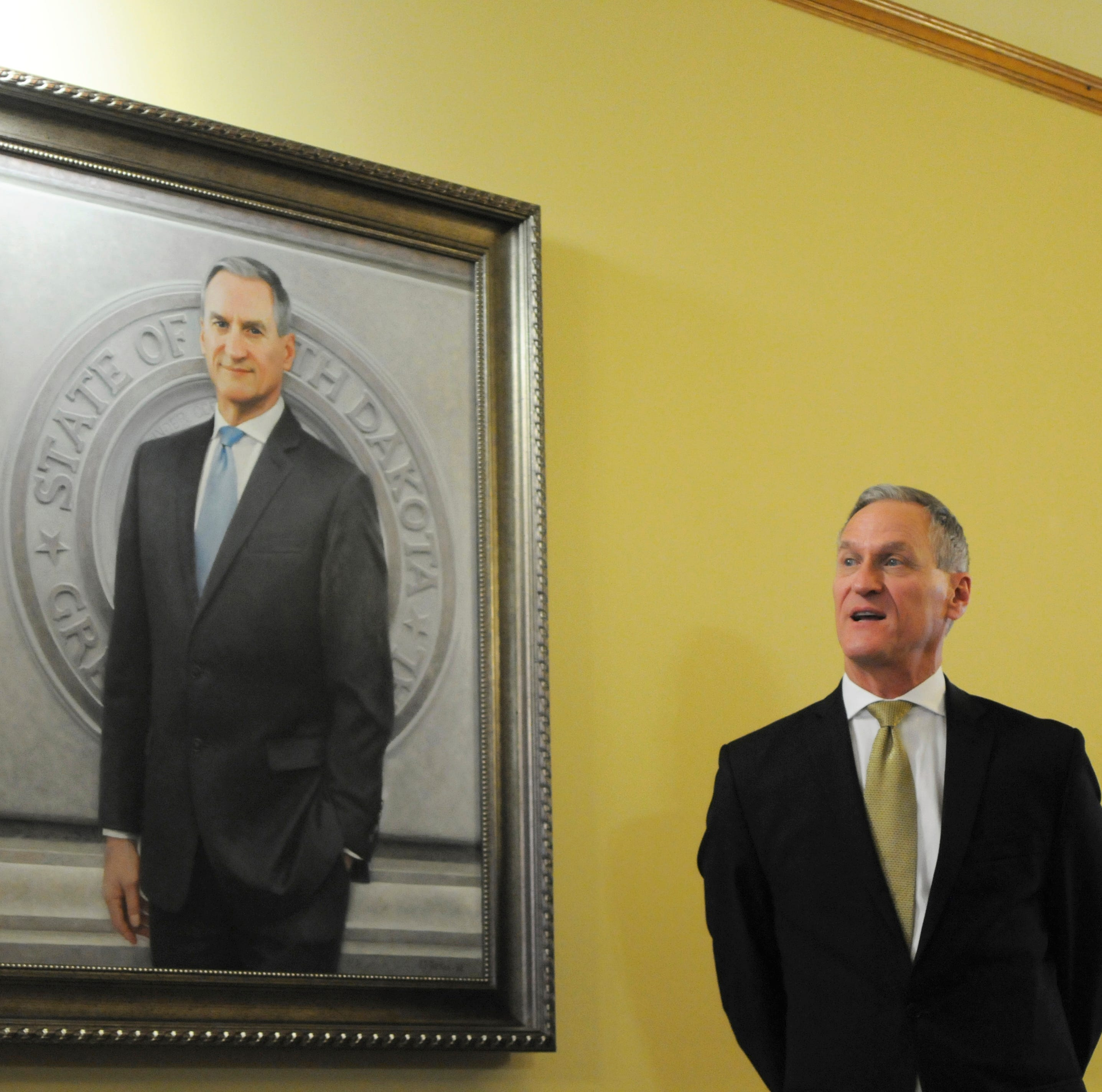 Gov. Dennis Daugaard speaks during the unveiling of his official Capitol portrait in Pierre on Tuesday after giving the state budget address. Connecticut artist Susan Booke Durkee painted the portrait after being chosen through a national selection process.