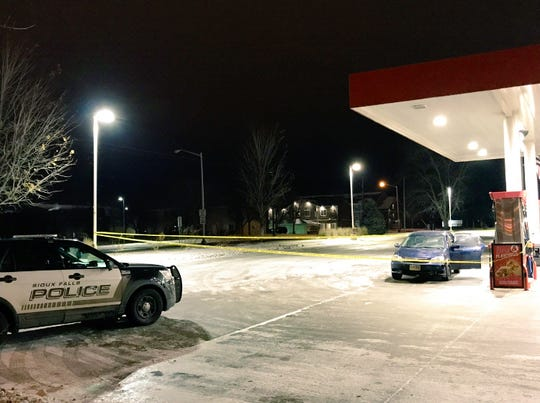 Police investigating an incident at the Kum & Go gas station near Sixth Street and Sycamore Avenue on Monday, Dec. 3, 2018.