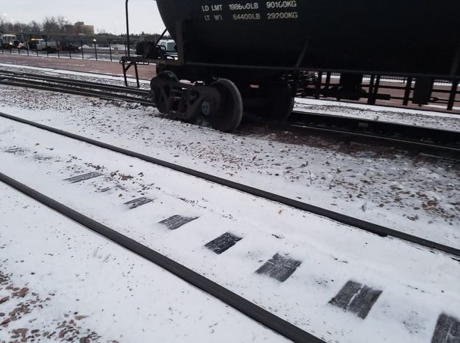 A train derailed near Sixth Street and Weber Avenue in Sioux Falls on Monday, Dec. 4, 2018, causing the road to close while authorities worked to remove the train.