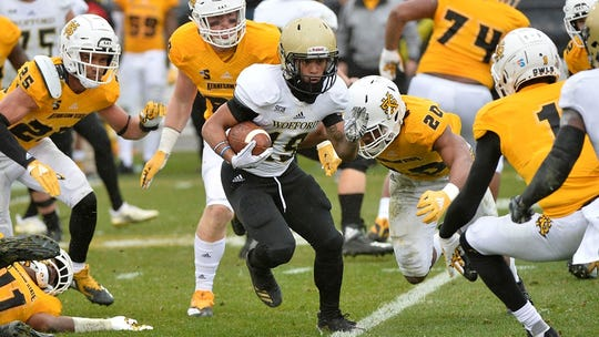 Kennesaw State defenders close in on a Wofford ballcarrier in last week's 13-10 playoff win