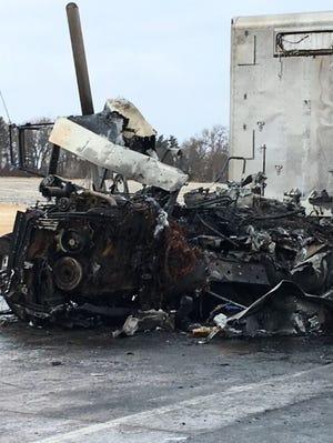 Four semi-trucks were involved in a fiery crash near Arlington on Tuesday morning, Dec. 4, 2018.