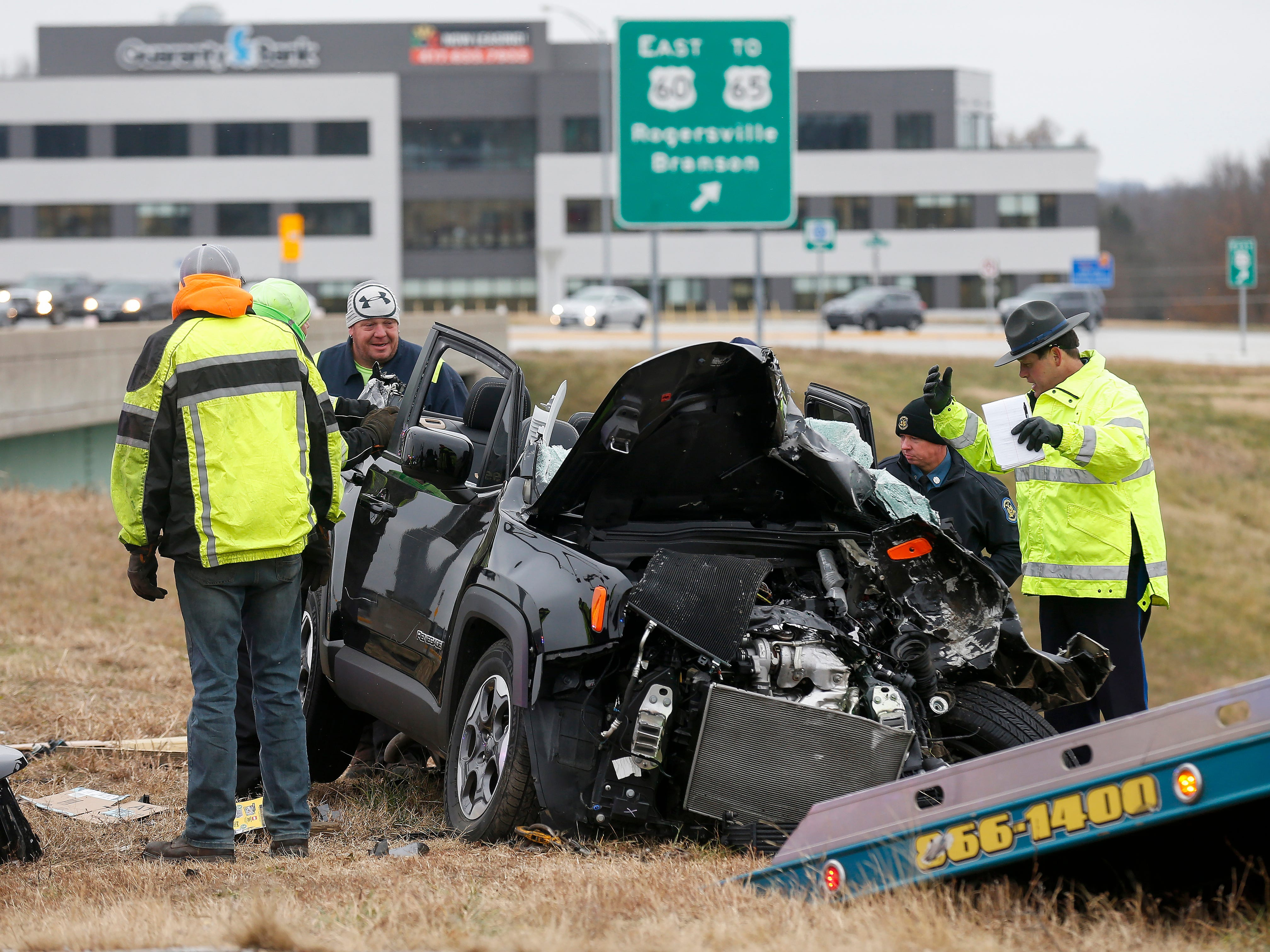 Law enforcement works the scene of a fatal accident near the westbound entrance ramp to James River Freeway at Glenstone Avenue on Tuesday, Dec. 4, 2018.
