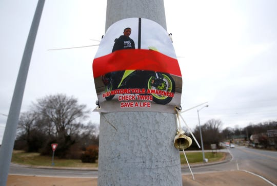A memorial for Dakota Randolph, who was killed in a motorcycle accident last week, on a light pole at the intersection of Mt. Vernon Street and Kansas Expressway.