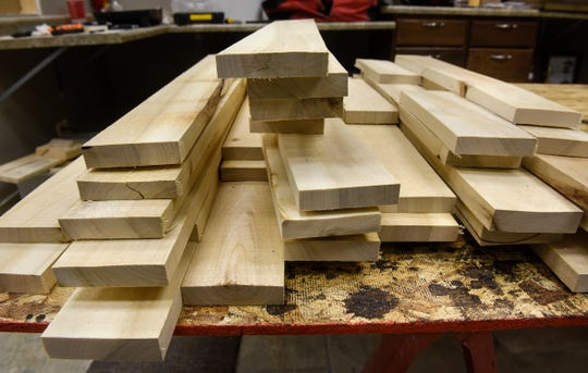 Reclaimed pieces of wood are prepared for a project at Serenity Wood in St. Cloud.