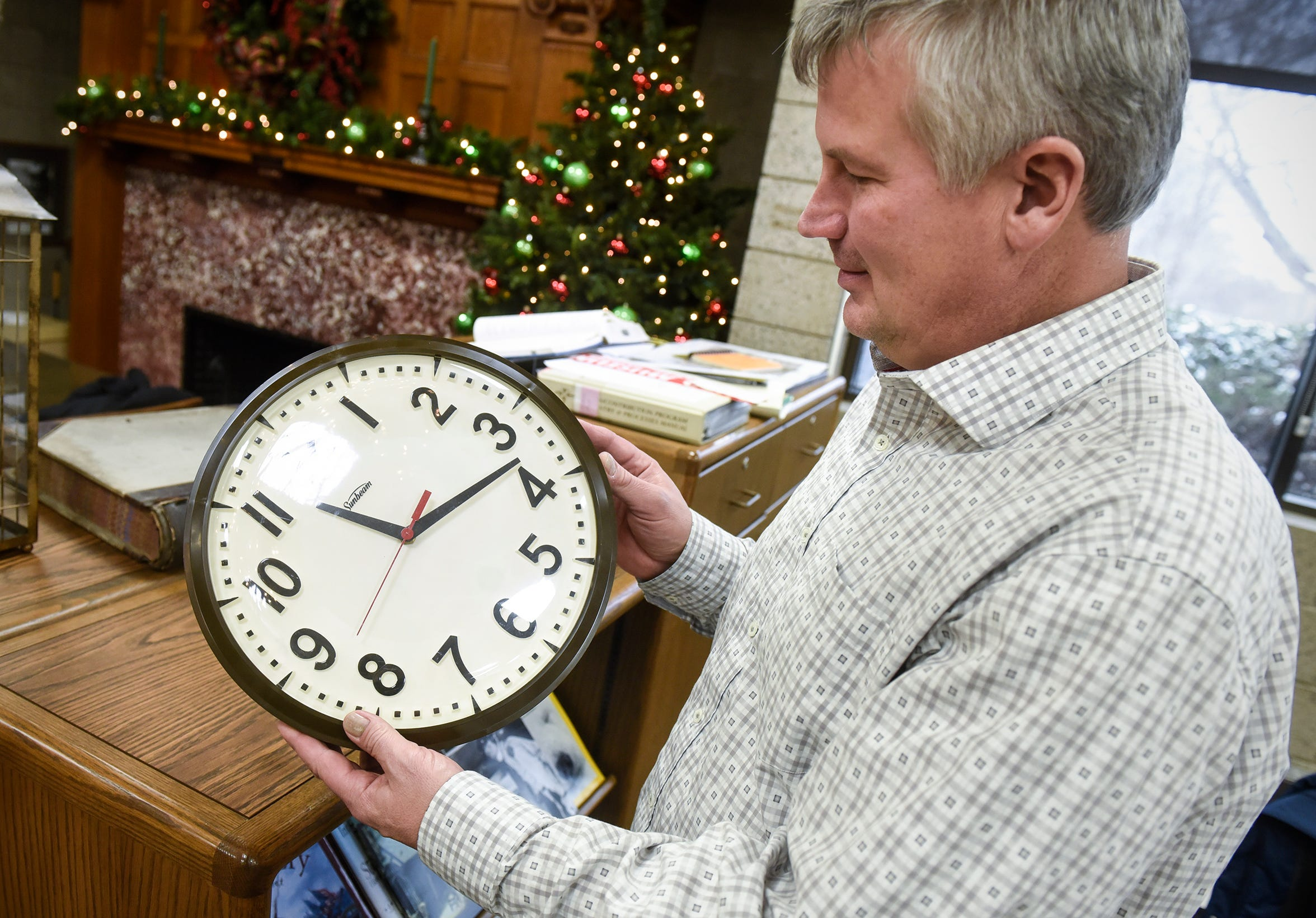 Stearns History Museum head archivist Steve Penick holds a clock that was knocked off the wall of the Stearns County Courts facility during the gas explosion of 1998 in St. Cloud.