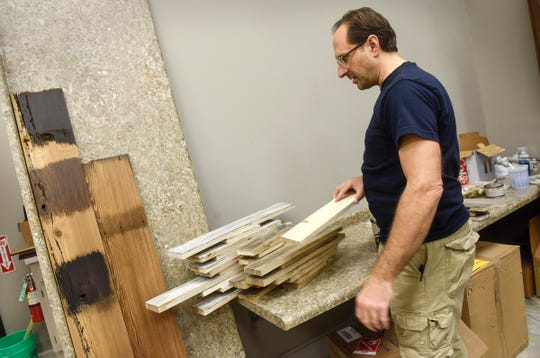 Owner Chad Peda talks about processes used to reclaim pieces of wood Tuesday, Dec. 4, at Serenity Design in St. Cloud