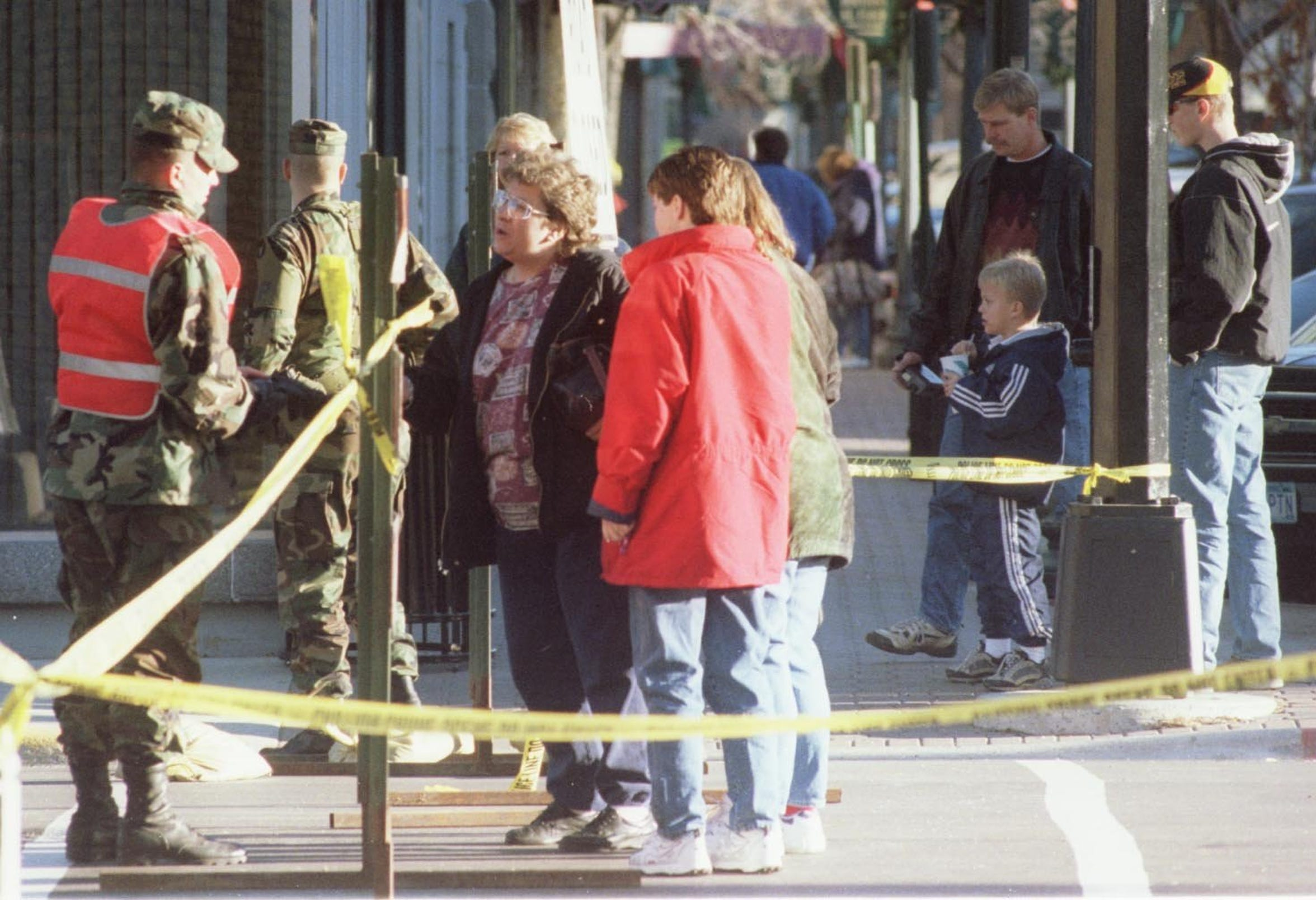 With several blocks of downtown St. Cloud off limits the day after the downtown explosion, National Guard troops explained to people how to get around.