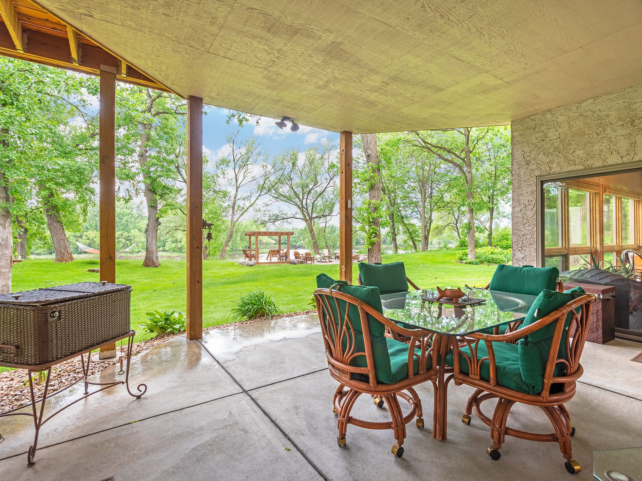 Just outside the family room is a large covered patio which faces the river.