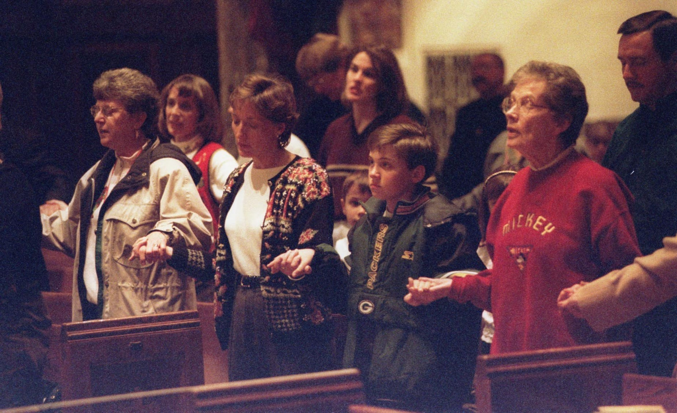 Parishioners joined hands across the center aisle and prayed during a service the evening of Dec. 11, 1998 at St. Mary's Cathedral in downtown St. Cloud for victims of the explosion that leveled the Bellantti's Pizza & Deli building Friday morning.