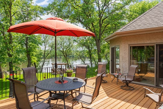 The upper level of the home offers a large deck that spans a section of the house and allows for greater views of the property.