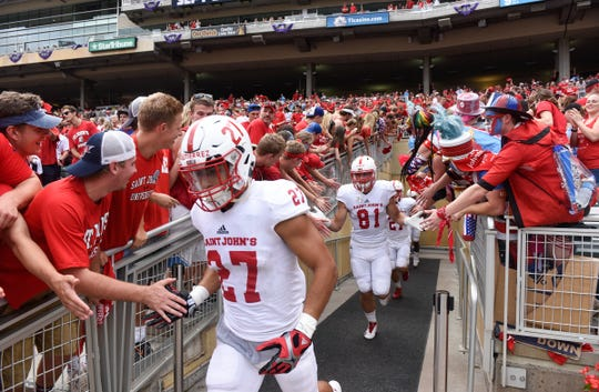 St. John's University players take the field during the Saturday, Sept. 23, 2017, game at Target Field in Minneapolis.