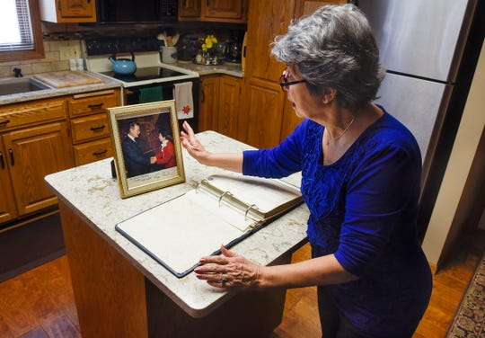 Joanne Benson talks about her memories of meeting George H.W. Bush during a campaign stop in St. Cloud in 1986 during an interview at her home Tuesday, Dec. 4, in St. Cloud.