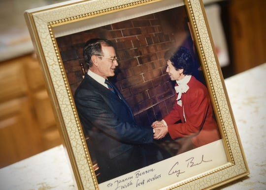 Joanne Benson keeps a photo of herself and George H.W. Bush with other mementos from her time in office in her St. Cloud home.