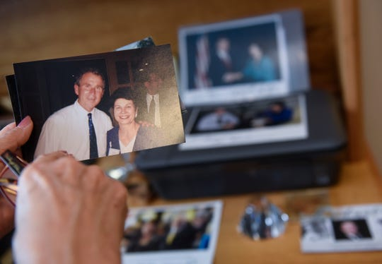 Joanne Benson holds a photo of herself and George W. Bush that she keeps with other memorabilia from her service in politics in her St. Cloud home.