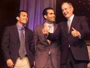 """John """"Jebby"""" Bush, and brother George P. Bush watch their grandfather, former President George H. W. Bush, give a """"thumbs up"""" sign at Governor Jeb Bush's Inauguration Party."""