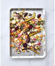 Great for roasting veggies, you can pickup a baking sheet anywhere and they typically run between $15-$20.