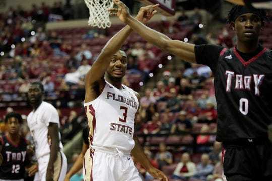 Florida State Seminoles guard Trent Forrest (3) and Troy Trojans forward Devante Foster (0) argue for their own possession during a game between FSU and Troy University at Donald L. Tucker Civic Center Monday, Dec. 3, 2018.
