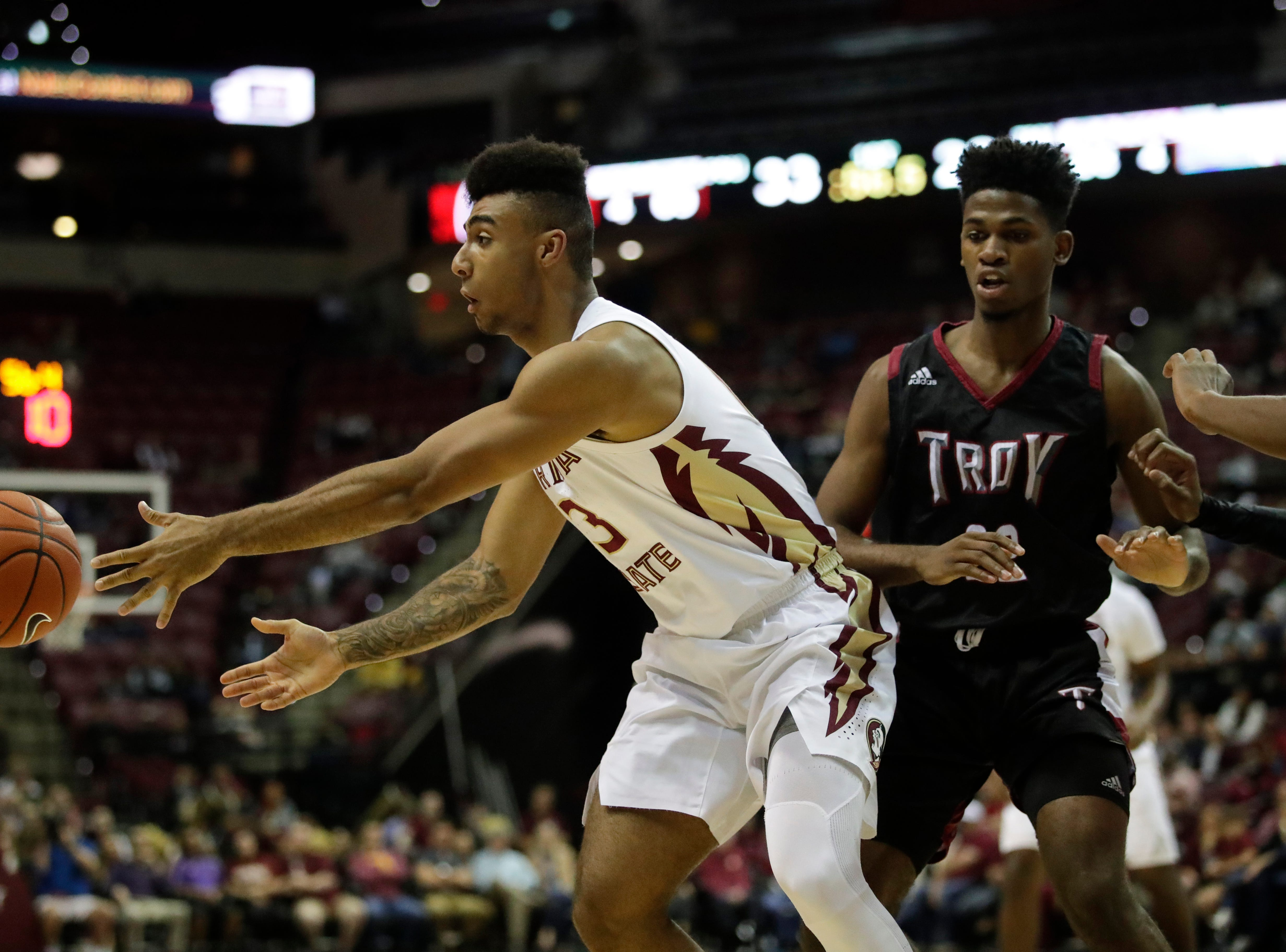 Florida State Seminoles guard Trent Forrest (3) passes the ball to a teammate during a game between FSU and Troy University at Donald L. Tucker Civic Center Monday, Dec. 3, 2018.