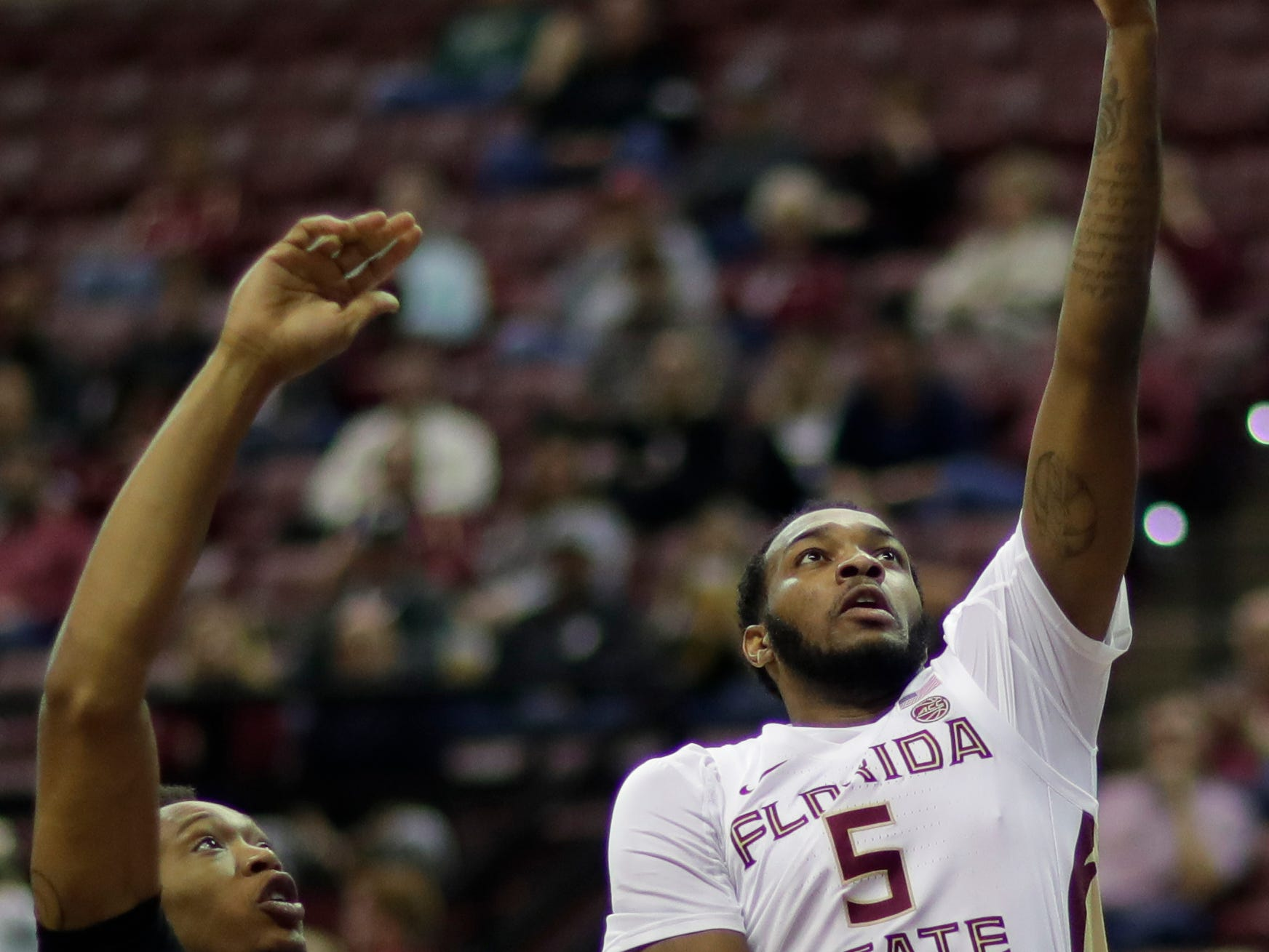 Florida State Seminoles guard PJ Savoy (5) puts up a lay up during a game between FSU and Troy University at Donald L. Tucker Civic Center Monday, Dec. 3, 2018.