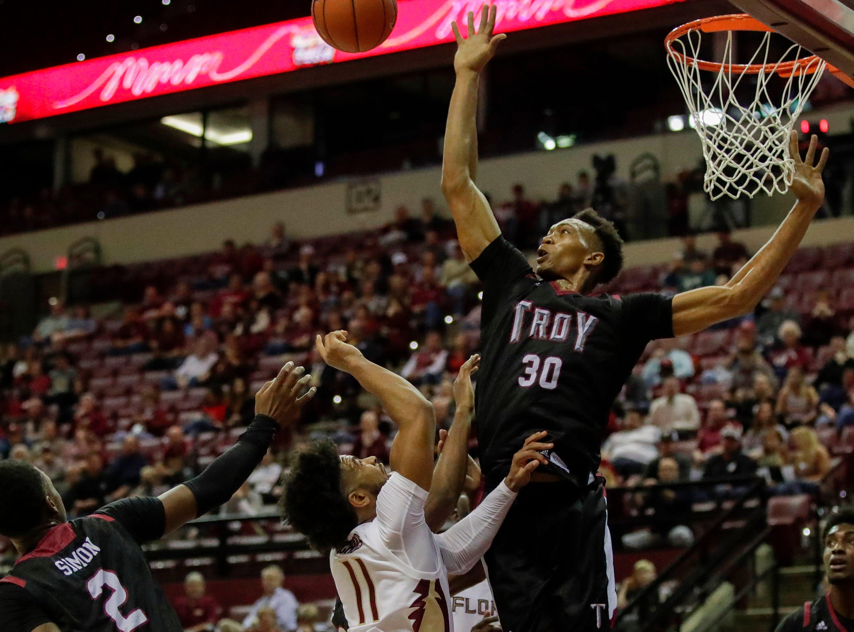 Troy Trojans forward Alex Hicks (30) blocks the shot of Florida State Seminoles guard David Nichols (11) during a game between FSU and Troy University at Donald L. Tucker Civic Center Monday, Dec. 3, 2018.