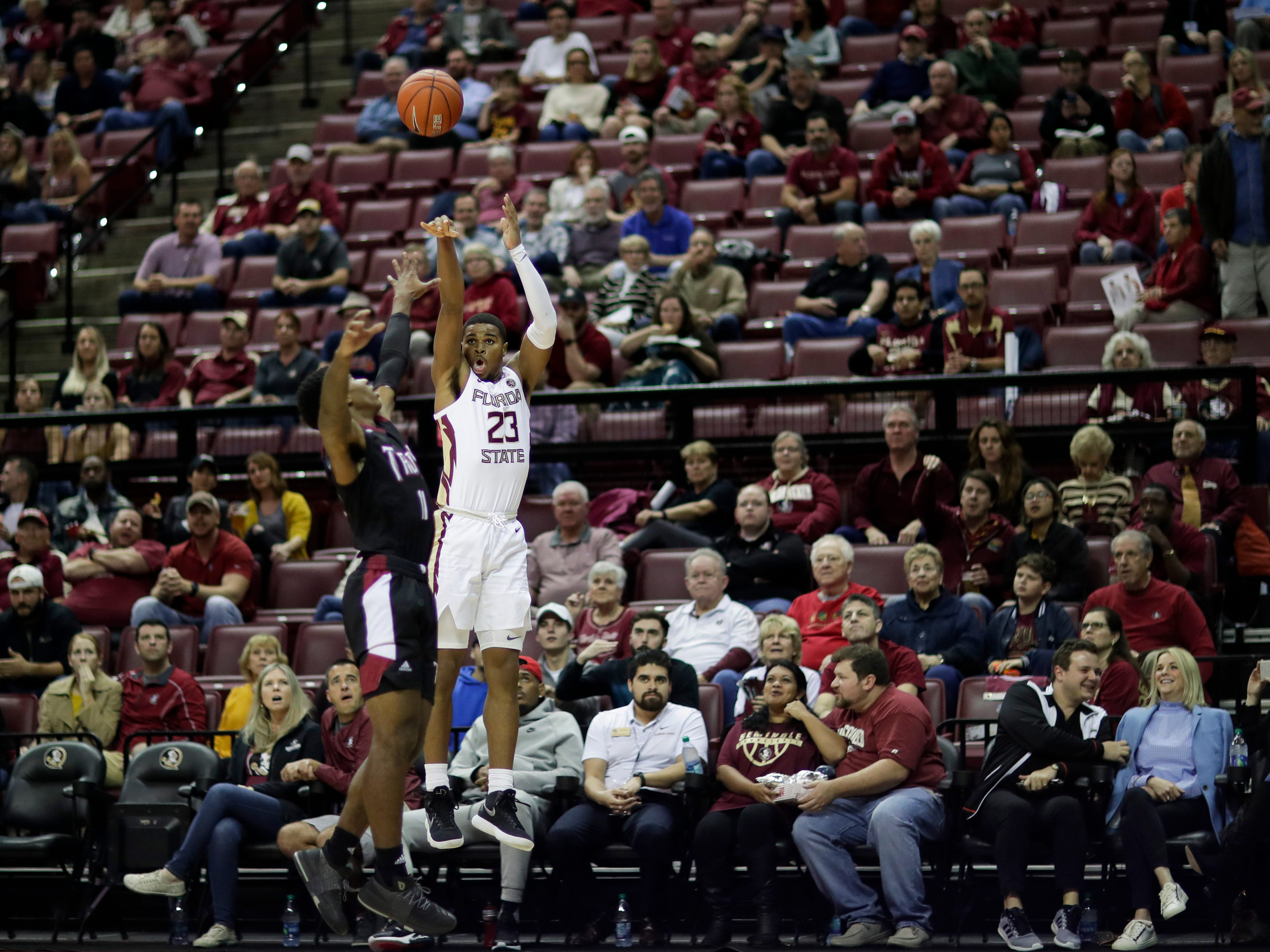 Florida State Seminoles guard M.J. Walker (23) shoots a three during a game between FSU and Troy University at Donald L. Tucker Civic Center Monday, Dec. 3, 2018.