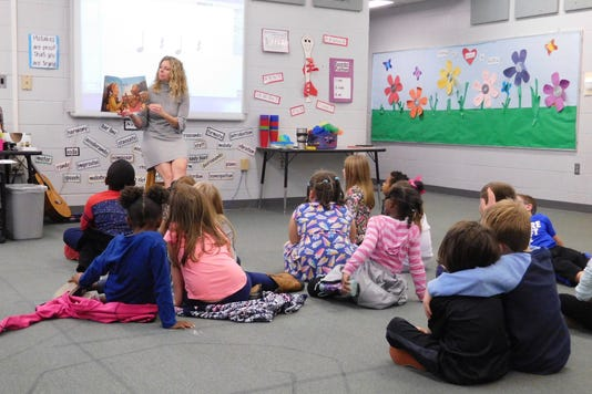 Holly Pursino Reads Aloud To Her Youngest Musicians