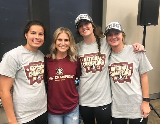 Emily Madril, Michalea Hahn, Anna Patten and Bella Dorsy celebrate winning the national title at Champions Club inside Doak Campbell Stadium. Hahn was a mentor for the team in 2018.