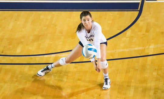 Former Leon volleyball star Elyse Thompson (10) digs a ball for her Emory team. Thompson just won the NCAA Division III National Championship.