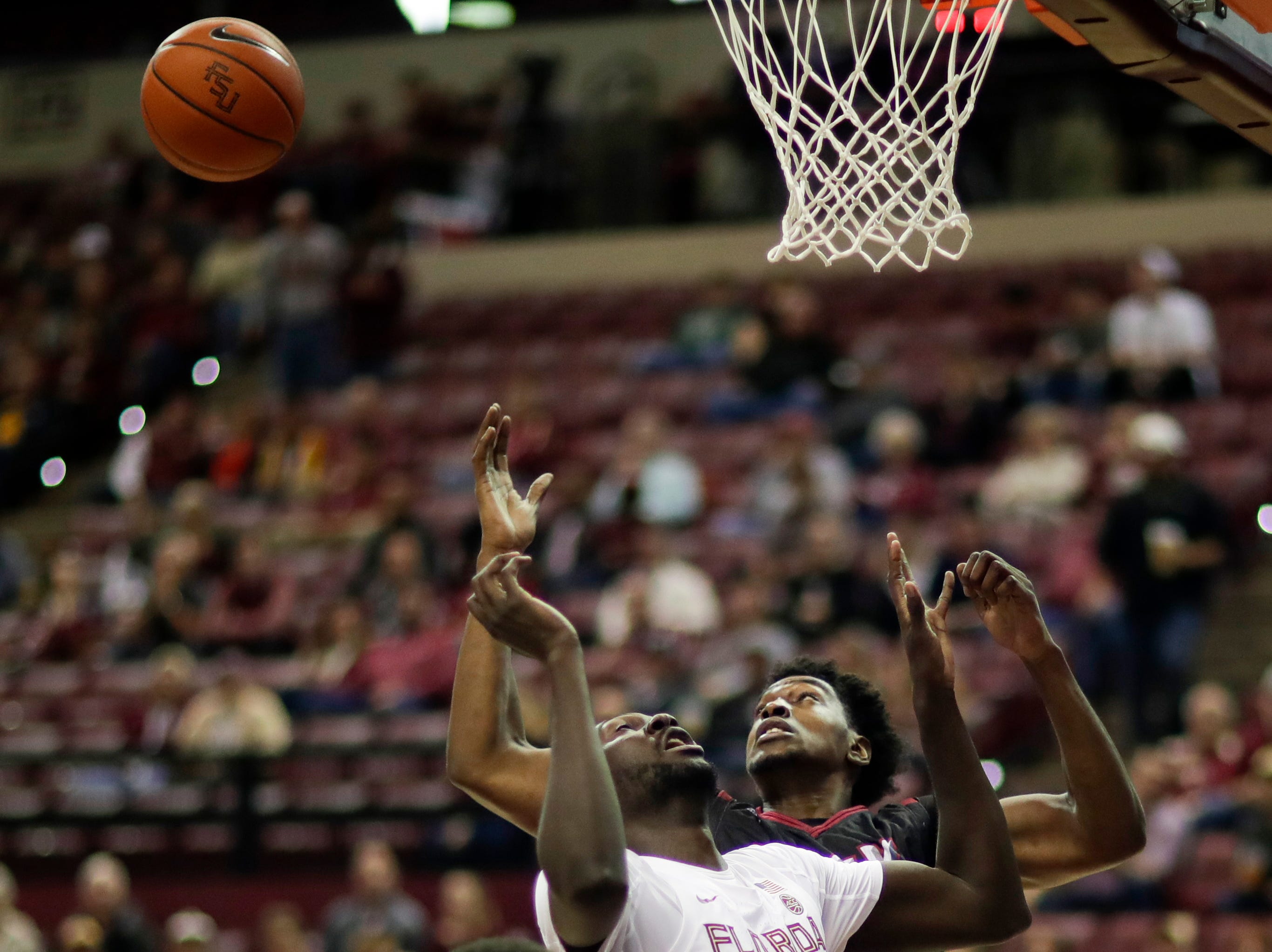 Florida State Seminoles center Christ Koumadje (21) and Florida State Seminoles guard M.J. Walker (23) watch as a rebound gets away from them during a game between FSU and Troy University at Donald L. Tucker Civic Center Monday, Dec. 3, 2018.