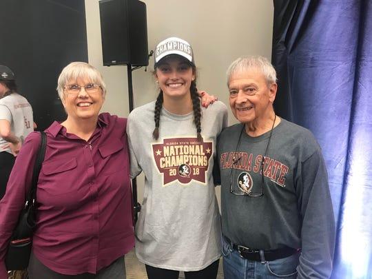 FSU goalie Caroline Jeffers with grandparents Lynn and Bob Glover