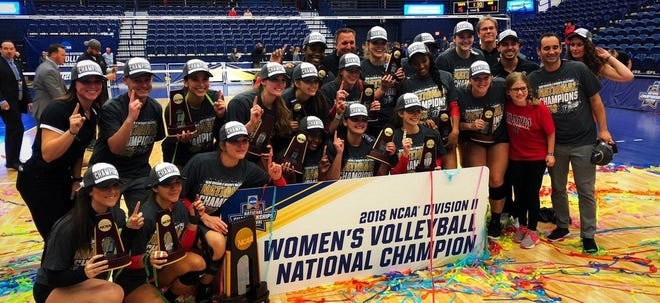 Former Florida High star Nylah Demps (top row, left of hat-less coach), a four-time first-team All-Big Bend outside hitter with the Seminoles, won a  Division II national title with the University of Tampa.