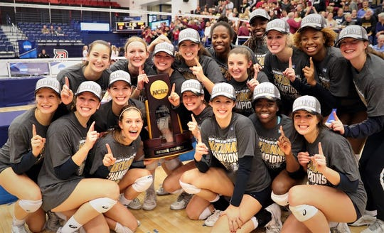 Former Leon volleyball star Elyse Thompson (top row, fourth from left) with her Emory teammates, who just won the NCAA Division III National Championship.