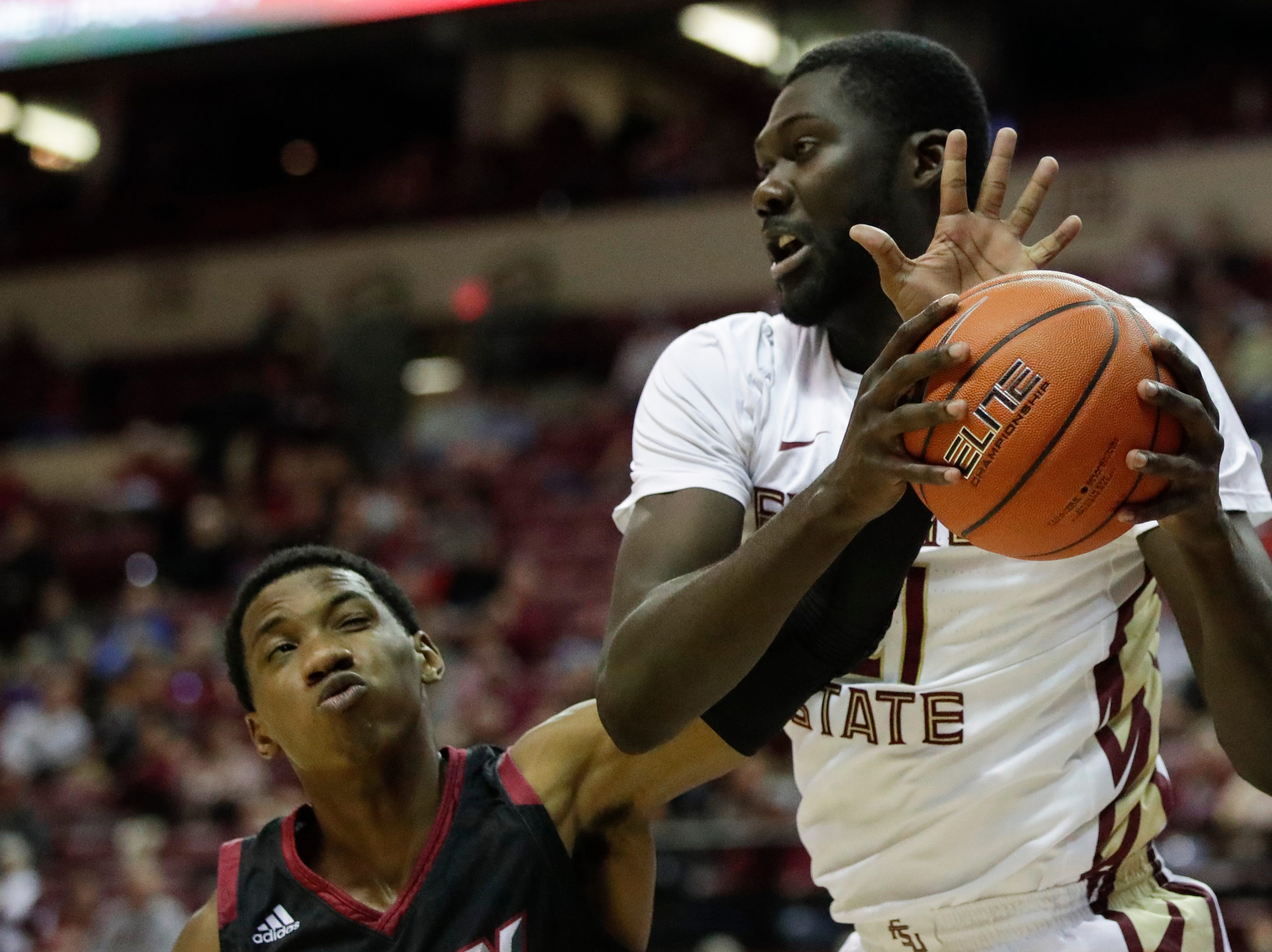 Florida State Seminoles center Christ Koumadje (21) tries to keep the rebounded ball during a game between FSU and Troy University at Donald L. Tucker Civic Center Monday, Dec. 3, 2018.