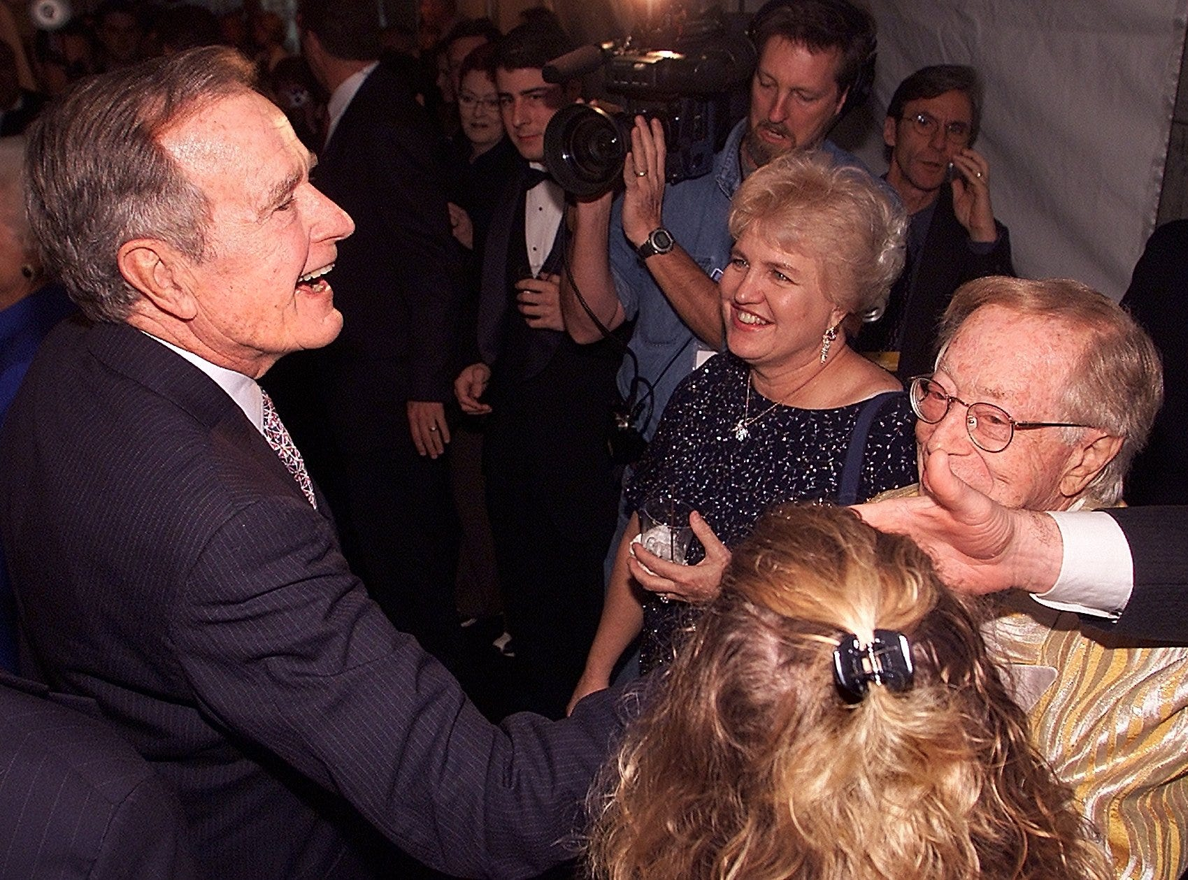 Former President George H. W. Bush greets the crowd at his son Governor Jeb Bush's Inauguration Party.