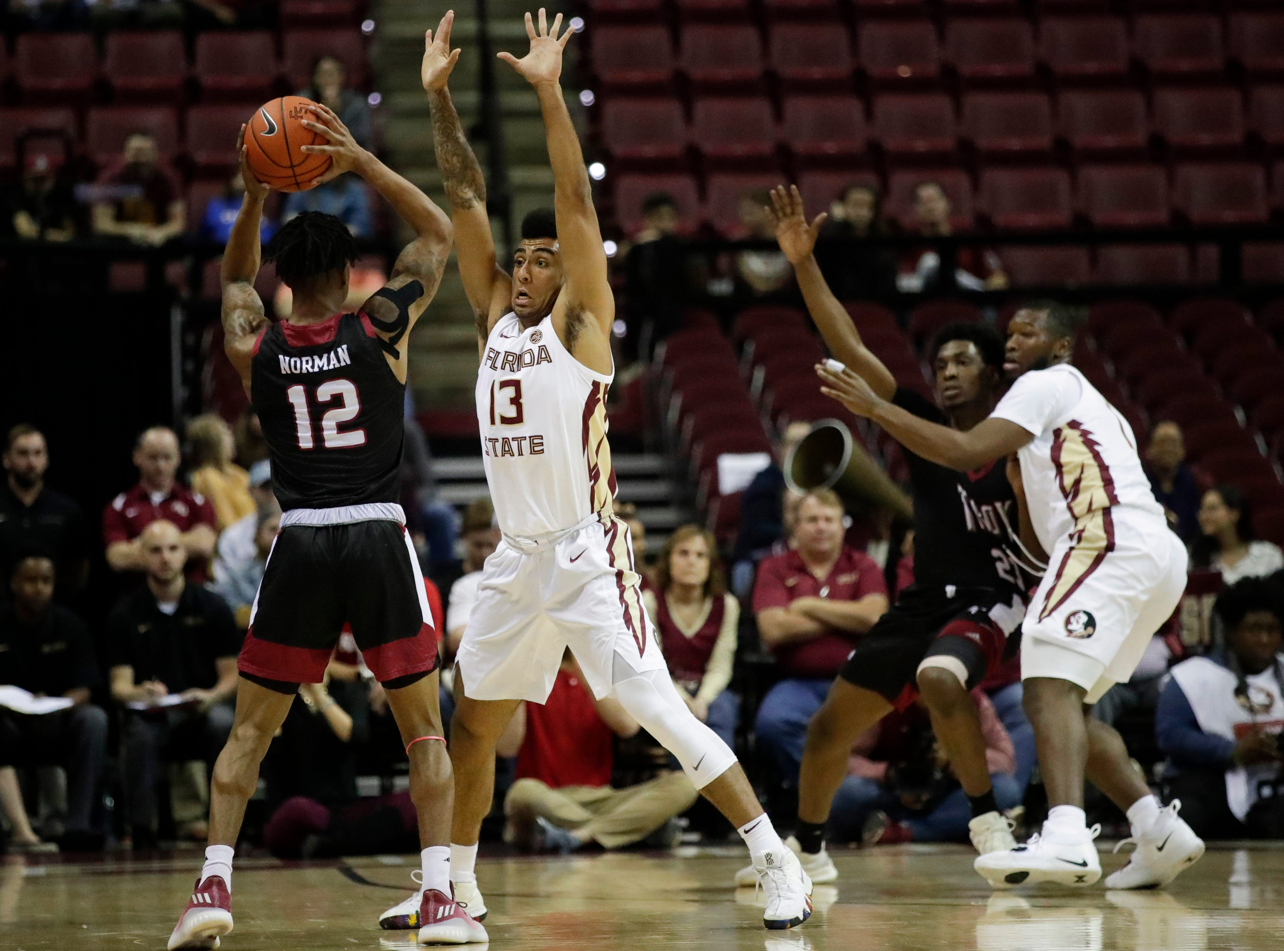 Florida State Seminoles guard Anthony Polite (13) guards Troy Trojans guard Charles Norman (12) during a game between FSU and Troy University at Donald L. Tucker Civic Center Monday, Dec. 3, 2018.