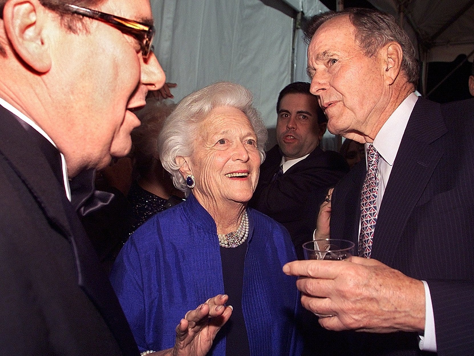 Former first lady Barbara Bush (center) and former President George H. W. Bush, right, talk to Pat Roberts, head of Florida Broadcasting, left, at Gov. Jeb Bush's Inauguration Party.  Phil Sears/Democrat files Former First Lady Barbara Bush (center) and former President George H. W. Bush, right, talk to Pat Roberts, head of Florida Broadcasting, left, at Governor Jeb Bush's Inauguration Party.