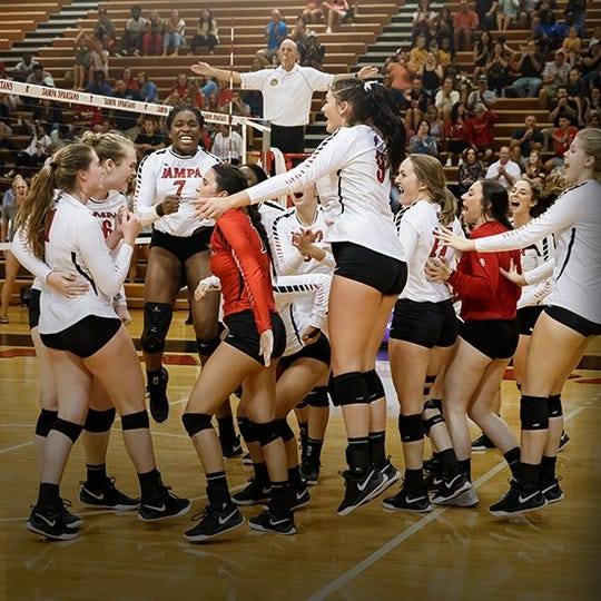 Former Florida High star Nylah Demps (7), a four-time first-team All-Big Bend outside hitter with the Seminoles, won a  Division II national title with the University of Tampa.