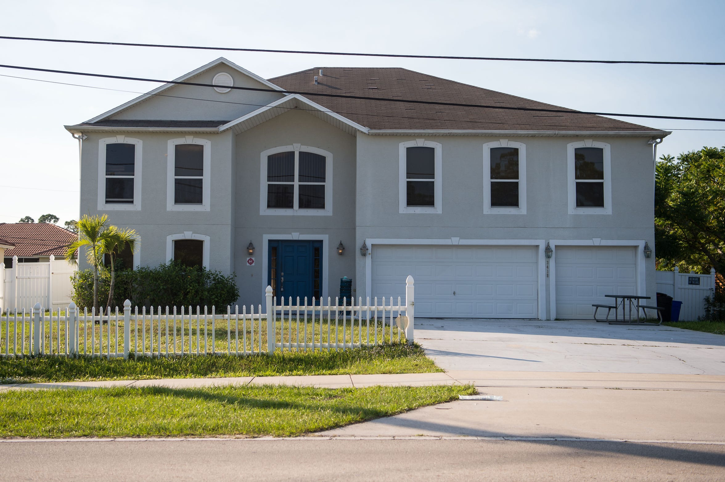 """A six-bedroom residence on Southwest Savona Boulevard — reported to house 40 players and a """"house mom"""" for Nation Christian Academy — is seen Monday, Dec. 3, 2018, in Port St. Lucie. The post-graduate football team had a winning first season, but various concerns have come to light after a profanity-laced tirade from school CEO Mike Woodbury went viral."""