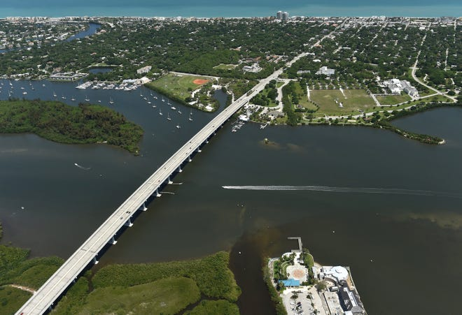 An aerial of the Merrill P. Barber Bridge with Vero Beach's MacWilliam and Riverside parks in the background on April 4, 2016.