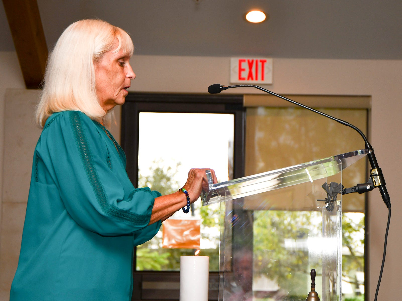 Roberta Scott, co-founder of the Interfaith Alliance of the Treasure Coast and event organizer, opened the Nov. 18 Thanksgiving service with a candle lighting.