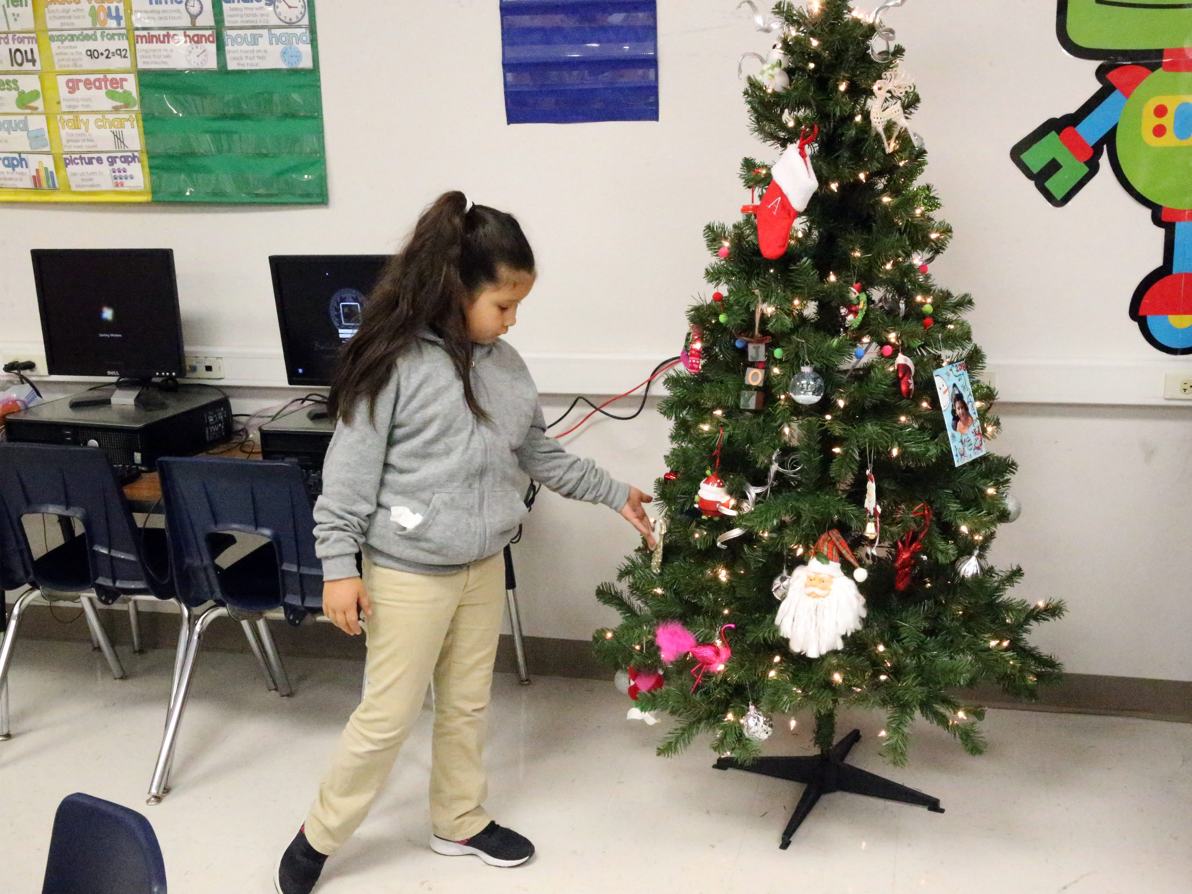 Jacquelynne Chavez looks at the classroom Christmas tree.