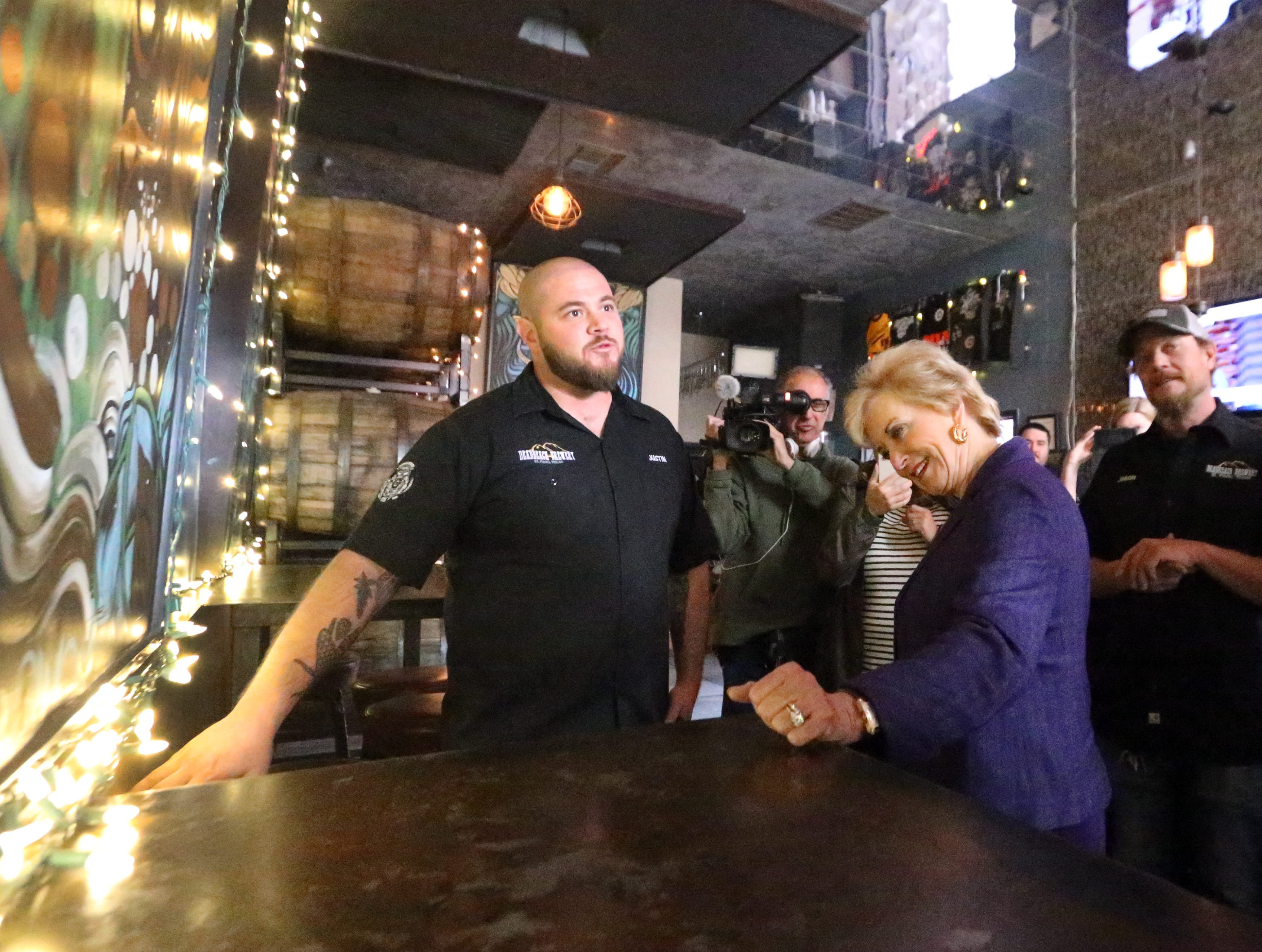 U.S. Small Business Administration director Linda McMahon, center, takes a tour of DeadBeach Brewery at 406b Durango Street during a visit to El Paso Tuesday.